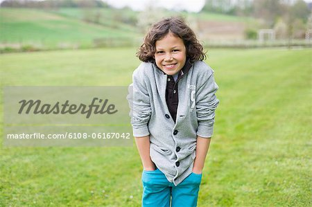 Portrait of a boy smiling in a field Stock Photo - Premium Royalty-Free, Image code: 6108-06167042