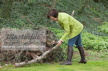 Woman cleaning her garden