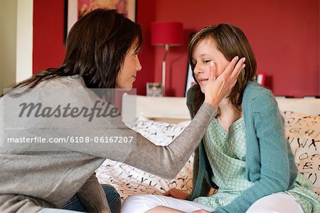 Woman consoling her sad daughter in the bedroom Stock Photo - Premium Royalty-Free, Image code: 6108-06167207