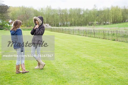 Woman with her daughter standing in a field Stock Photo - Premium Royalty-Free, Image code: 6108-06167367