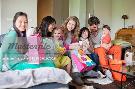 Family at a birthday party Stock Photo - Premium Royalty-Free, Image code: 6108-06167519