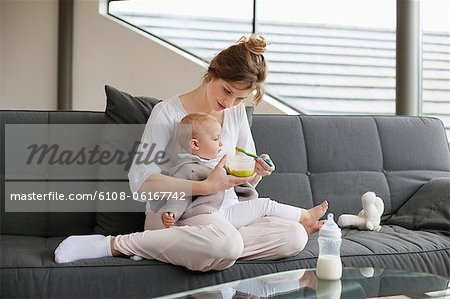 Woman feeding her daughter Stock Photo - Premium Royalty-Free, Image code: 6108-06167742
