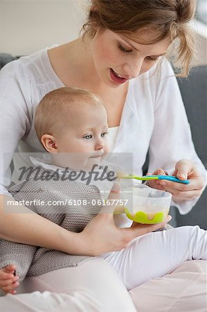 Woman feeding her daughter Stock Photo - Premium Royalty-Free, Image code: 6108-06167757