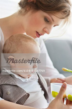 Woman feeding her daughter Stock Photo - Premium Royalty-Free, Image code: 6108-06167769