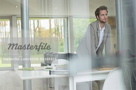 Interior designer working in the office Stock Photo - Premium Royalty-Free, Image code: 6108-06168101