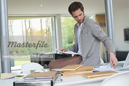 Interior designer working in the office Stock Photo - Premium Royalty-Free, Image code: 6108-06168115