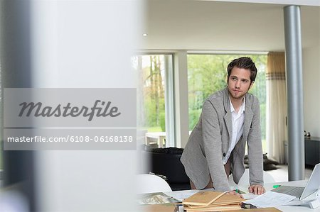 Interior designer working in the office Stock Photo - Premium Royalty-Free, Image code: 6108-06168138