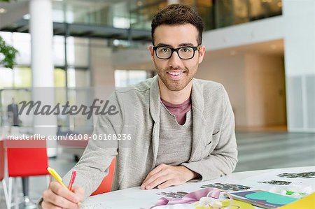 Male fashion designer working in an office - Stock Photo ...