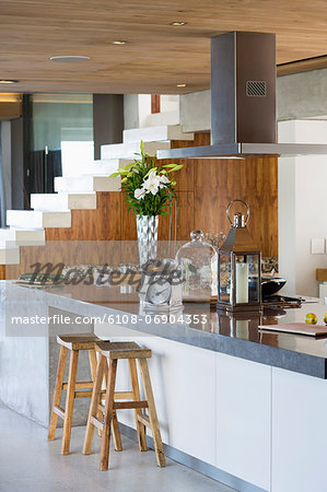 Interiors of a kitchen counter in a studio apartment Stock Photo - Premium Royalty-Free, Image code: 6108-06904353