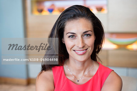 Portrait of a beautiful woman smiling Stock Photo - Premium Royalty-Free, Image code: 6108-06904498