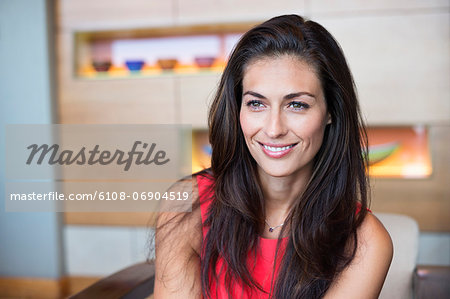 Close-up of a beautiful woman smiling Stock Photo - Premium Royalty-Free, Image code: 6108-06904519