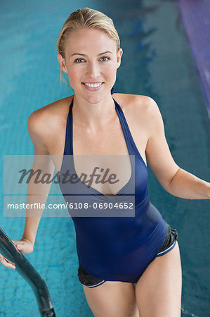 Portrait of a woman standing in a swimming pool Stock Photo - Premium Royalty-Free, Image code: 6108-06904652