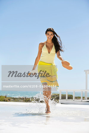 Beautiful woman enjoying on the beach Stock Photo - Premium Royalty-Free, Image code: 6108-06904684