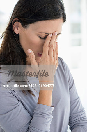 Close-up of a woman suffering from a headache Stock Photo - Premium Royalty-Free, Image code: 6108-06904775