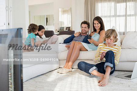 Family using electronics gadget Stock Photo - Premium Royalty-Free, Image code: 6108-06904909