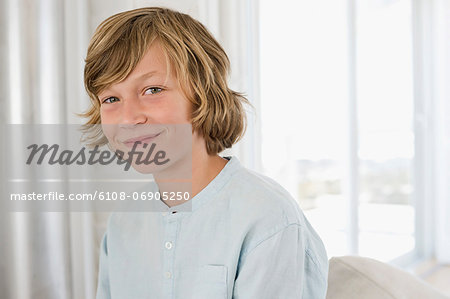 Portrait of a boy smiling Stock Photo - Premium Royalty-Free, Image code: 6108-06905250