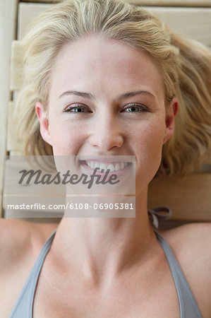 Portrait of a smiling woman resting in a sauna Stock Photo - Premium Royalty-Free, Image code: 6108-06905381