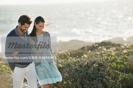 Couple walking on the beach Stock Photo - Premium Royalty-Free, Image code: 6108-06905443