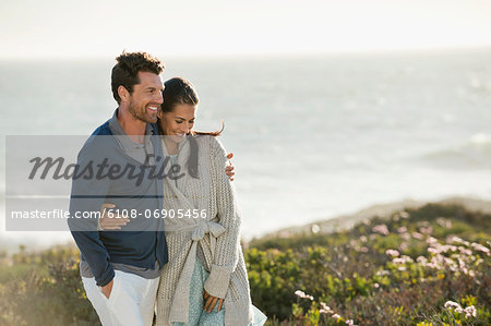 Couple walking on the beach Stock Photo - Premium Royalty-Free, Image code: 6108-06905456
