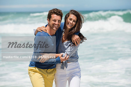 Couple enjoying on the beach Stock Photo - Premium Royalty-Free, Image code: 6108-06905459