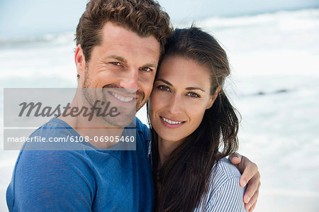 Close-up of a happy couple on the beach Stock Photo - Premium Royalty-Free, Image code: 6108-06905460