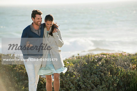 Couple walking on the beach Stock Photo - Premium Royalty-Free, Image code: 6108-06905479