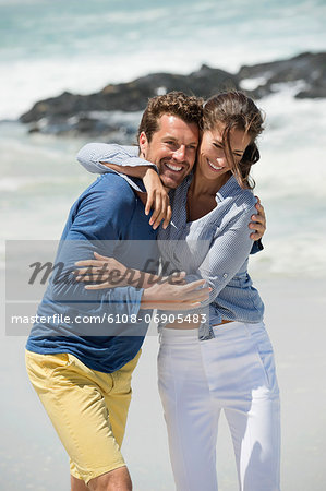 Couple enjoying on the beach Stock Photo - Premium Royalty-Free, Image code: 6108-06905483
