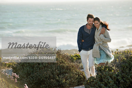 Couple walking on the beach Stock Photo - Premium Royalty-Free, Image code: 6108-06905487