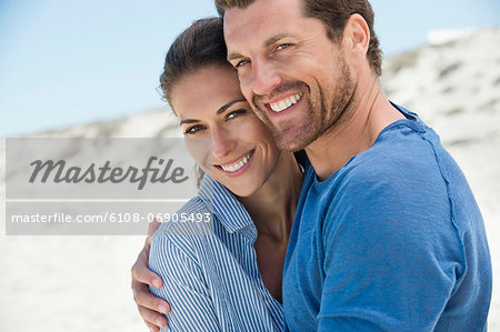 Close-up of a happy couple on the beach Stock Photo - Premium Royalty-Free, Image code: 6108-06905493