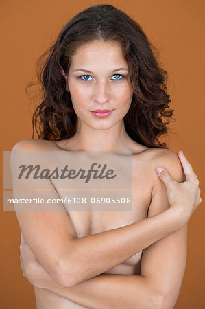 Portrait of a naked woman posing Stock Photo - Premium Royalty-Free, Image code: 6108-06905508