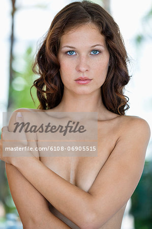 Portrait of a naked woman posing Stock Photo - Premium Royalty-Free, Image code: 6108-06905515