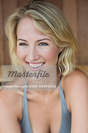 Close-up of a smiling woman in a sauna Stock Photo - Premium Royalty-Free, Image code: 6108-06905536