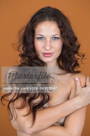 Portrait of a naked woman posing Stock Photo - Premium Royalty-Free, Image code: 6108-06905547