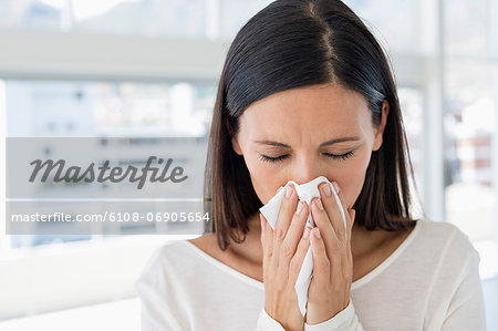 Close-up of a woman sneezing Stock Photo - Premium Royalty-Free, Image code: 6108-06905654