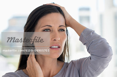 Close-up of a woman suffering from a headache Stock Photo - Premium Royalty-Free, Image code: 6108-06905703