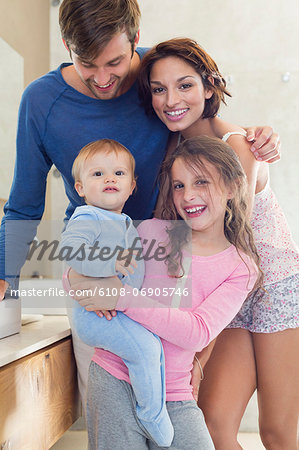 Happy family in a bathroom Stock Photo - Premium Royalty-Free, Image code: 6108-06905746