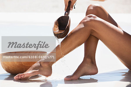 Woman bathing on the beach Stock Photo - Premium Royalty-Free, Image code: 6108-06905771