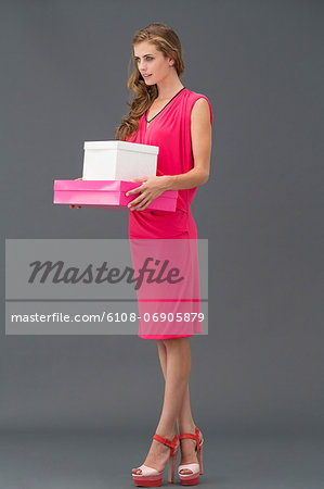 Woman carrying boxes Stock Photo - Premium Royalty-Free, Image code: 6108-06905879
