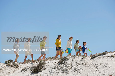 Family walking on the beach Stock Photo - Premium Royalty-Free, Image code: 6108-06905891