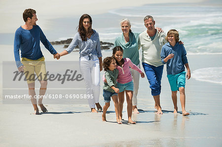 Family walking on the beach Stock Photo - Premium Royalty-Free, Image code: 6108-06905895