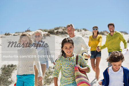 Family walking on the beach Stock Photo - Premium Royalty-Free, Image code: 6108-06905896