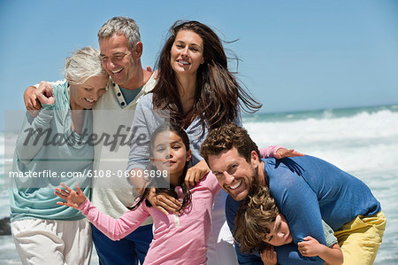 Family smiling on the beach