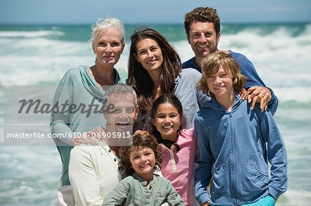 Portrait of a family smiling on the beach Stock Photo - Premium Royalty-Free, Image code: 6108-06905913