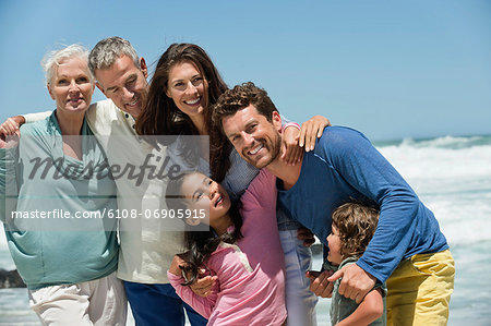 Family smiling on the beach Stock Photo - Premium Royalty-Free, Image code: 6108-06905915