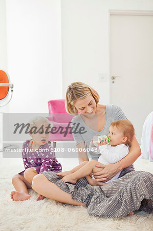 Woman feeding milk her baby with a bottle Stock Photo - Premium Royalty-Free, Image code: 6108-06906043