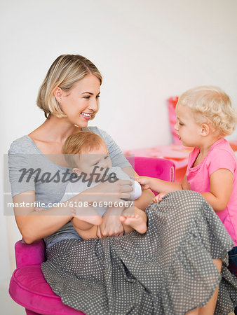 Smiling mother with her children Stock Photo - Premium Royalty-Free, Image code: 6108-06906067