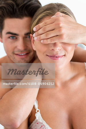 Man covering eyes of his girlfriend Stock Photo - Premium Royalty-Free, Image code: 6108-06906212