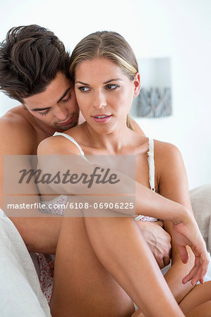 Romantic couple on the bed Stock Photo - Premium Royalty-Free, Image code: 6108-06906225