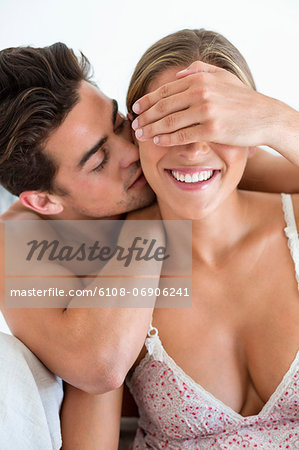 Romantic couple on the bed Stock Photo - Premium Royalty-Free, Image code: 6108-06906241