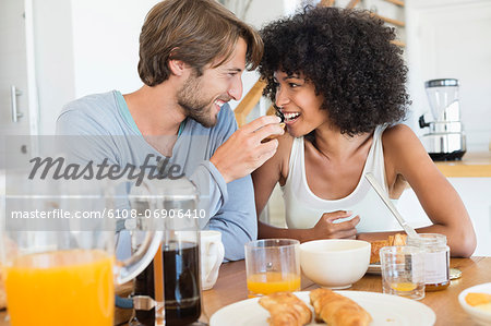 Man feeding food to her wife Stock Photo - Premium Royalty-Free, Image code: 6108-06906410